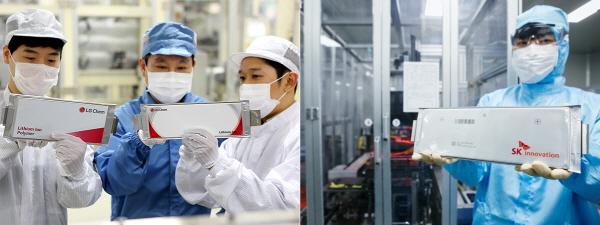 LG화학과 SK이노베이션의 연구원이 전기차 배터리를 확인하고 있다. [사진=LG화학, SK이노베이션]